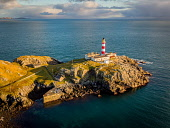Eilean Glas Lighthouse on the Isle of Scaplay, Outer Hebrides, Scotland Jason Baxter /Scottish Viewpoint Spring,aerial,aerial photograph,architecture,bay,beautiful,blue sky,building,coast,coastal,coastline,eilean glas,hebridean isles,isle of harris,lighthouse,outer hebrides,remote,rugged,rugged coastline