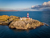 An Aerial photograph overlooking Eilean Glas Lighthouse on the Isle of Scaplay, Outer Hebrides, Scotland Jason Baxter /Scottish Viewpoint Spring,aerial,aerial photograph,architecture,bay,beautiful,blue sky,building,coast,coastal,coastline,drone,eilean glas,hebridean isles,isle of harris,lighthouse,outer hebrides,remote,rugged,rugged coa