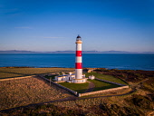 Early morning light over Tarbat Ness Lighthouse using a drone Jason Baxter /Scottish Viewpoint Portmahomack,Robert Stevenson,Spring,Tain,aerial,aerial photograph,am,beautiful,beauty,coast,coastal,coastline,dawn,drone,geography,highlands,light-house,lighthouse,morning,morning light,natural light