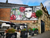 After pubs open in Scotland, the Charles Rennie Mackintosh mural outside the Clutha Bar in Glasgow reminds customers that staff are following new guidelines on wearing masks. Tony Clerkson /Scottish Viewpoint Charles Rennie Mackintosh Coronavirus mask mural,Charles Rennie Mackintosh mural,Clutha Bar,Clutha Vaults,Coronavirus,Coronavirus mask,Covid-19,Covid-19 masks,Glasgow,Glasgow City Centre,Glasgow lockd