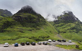 Glen Coe, Scotland, UK. 4 July, 2020. Tourists travel to Glen Coe on first weekend after 5 mile travel restriction was lifted by the Scottish Government. Iain Masterton /Scottish Viewpoint Scotland,Scottish,glen coe,tourists,covid-19,coronavirus,travel restictions,uk,untited Kingdom,britain,scenic,outdoors,tourism,highland,travelling,cars,car park,busy,many cars,viewpoint,mountains