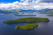 Aerial view of islands in Loch Lomond. Nearest Clairinsh, Inchcailloch and Inchfad in Loch Lomond and The Trossachs National Park,, Scotland, UK Iain Masterton /Scottish Viewpoint Loch Lomond Scotland,Scotland,Scottish Loch,Loch Lomond and The Trossachs national Park,Aerial view,drone image,travel,tourism,UK,United Kingdom,Britain,british,lake,scenic,daytime,elevated viewpoint,