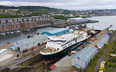 Aerial view of controversial CalMac ferry MV Glen Sannox in Dales Dry Dock in Greenock on the River Clyde, Scotland, UK Iain Masterton /Scottish Viewpoint Scotland,scottish,Greenock,MV Glen Sannox,Caledonian macbrayne ferry,scottish ferry,dales dry dock,repairs,UK,United Kingdom,Ferguson Marine,transport,transportation,infrastructure,River Clyde,aerial