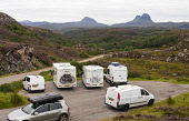 View of tourist camper vans and motorhomes in car park near Lochinver in Highland region of Scotland, UK Iain Masterton /Scottish Viewpoint Scotland,Scottish,travel,tourism,tourist industry,tourists,campervan campervans,motorhomes,motorhome,car park,parking lot,daytime,lochinver,scottish highlands,north coast 500,route,summer,UK,United Ki