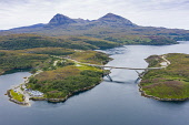 Aerial view of Kylesku Bridge crossing Loch a' Ch�irn Bh�in in Sutherland, Scotland, UK Iain Masterton /Scottish Viewpoint Kylesku Bridge Scotland,Scottish bridge,Highland,Sutherland,modern,transport,transportation,aerial view,drone,from above,infrastructure,north coast 500,travel,daytime,uk,United kingdom,britain,british