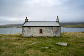 Old cottage at Papil, West Burra Island, Shetland, Scotland, UK Iain Masterton /Scottish Viewpoint Shetland,Scotland,Scottish island,Shetland islands,Shetland isles,Shetland Scotland,UK,United Kingdom,Britain,British,remote,south mainland,exterior,daytime,nobody,travel,countryside,rural,cottage,aba