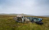Old fishing boat abandoned in a field at North Roe village, North Roe, Shetland, Scotland, UK Iain Masterton /Scottish Viewpoint Shetland,Scotland,Scottish island,Shetland islands,north roe,old fishing boat,abandoned,decay,decaying,solitary,isolated,fine art,Shetland isles,Shetland Scotland,UK,United Kingdom,Britain,British,rem
