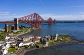 Aerial view of Forth Bridge crossing the River Forth and village of North Queensferry, Fife, Scotland, UK Iain Masterton /Scottish Viewpoint Forth Bridge Scotland,Forth Railway bridge Scotland,North Queensferry,Fife,Scotland,Scottish bridge,landmark,industrial heritage,UK,United Kingdom,britain,british,daytime,aerial view,drone,image,Firth
