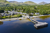 Aerial view of popular tourist village of Luss beside Loch Lomond in Argyll and Bute, Scotland, UK Iain Masterton /Scottish Viewpoint Luss scotland,Scotland,Scottish village,Argyll and Bute,Uk,united Kingdom,Britain,British,travel,tourism,tourist attraction,loch lomond,Luss,village of Luss,daytime,pier,sunshine,destination,villages,