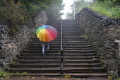 Woman with colourful umbrella climbs steps at Calton Hill on rainy day, Edinburgh, Scotland, UK Iain Masterton /Scottish Viewpoint Calton Hill Edinburgh,Scotland,Scottish city,rain,rainy weather,wet weather,umbrella,UK,united Kingdom,britain,british,daytime,travel,tourism,colourful umbrella,bad weather,raining