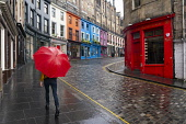 View of empty Victoria Street in Edinburgh during Covid-19 lockdown, Scotland UK Iain Masterton /Scottish Viewpoint Scotland,Scottish,Edinburgh,shops,shopping,retail industry,UK,United kingdom,britain,coronavirus,covid-19,shop,store,empty street,victoria street edinburgh,edinburgh old town,red umbrella,quiet,desert