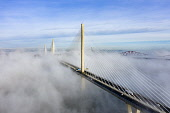Queensferry Crossing bridge shrouded in mist , South Queensferry, Scotland, UK Iain Masterton /Scottish Viewpoint South Queensferry,Scotland,Scottish,Queensferry Crossing bridge,weather,cloud inversion,fog,mist,foggy weather,UK,United Kingdom,britain,british,daytime,transport,infrastructure,drone image,from above