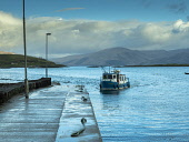 The Lismore Ferry arriving back at Port Appin, Argyll, on the shores of Loch Linnhe Allan Coutts  /Scottish Viewpoint Lismore,Port Appin,blue,boat,coast,crossing,end,ferry,highlands,hotel,house,island,isolated,jetty,light,loch,loch linnhe,mountains,passengers,pier,quiet,remote,sea,space,tranquility,west