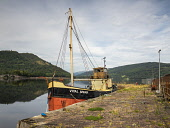 The Clyde puffer Vital Spark moored in Inveraray Harbour Allan Coutts  /Scottish Viewpoint clyde,puffer,loch fyne,boat,calm,argyll,argyll and bute,fishing,fishing boat,water,glasgow,highlands,inveraray,reflection,mountains,no people,outside,popular,ship,steam boat,tourist,tourism