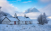 Snow covered Blackrock Cottage with mist covered Buachaille Etive Mor mountain in the distance in Glen Coe, Scottish Highlands, Scotland, UK Iain Masterton /Scottish Viewpoint Scotland,Scottish,glen coe,weather,cold,snow,snowy,snowfall,winter weather,uk,united kingdom,britain,british,outdoor,daytime,seasons,highland region,scottish highlands,scenery,travel,tourism,wintry we