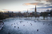 Ice hockey on  frozen pond at Queens Park in  Glasgow, Scotland, UK Iain Masterton /Scottish Viewpoint Scotland,Scottish,Glasgow,Queens Park,ice hockey,frozen pond,sport,amateur,winter,cold,outdoor,UK,United Kingdom,britain,british,recreation,public park  people busy,playing sport,cold weather,from abo