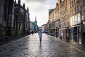 The Royal Mile in Edinburgh Old Town is almost deserted with no shops open during Covid-19 lockdown, Scotland ,UK Iain Masterton /Scottish Viewpoint Scotland,Scottish,Edinburgh,lockdown,shops,royal mile edinburgh,edinburgh old town,shopping,city centre,stores,covid-19,coronavirus,pandemic,uk,united kingdom,britain,british,people,street,closures,bu