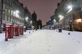 Winter night view of empty Royal Mile during snow storm, Edinburgh, Scotland, UK Iain Masterton /Scottish Viewpoint Scotland,Scottish city,Edinburgh winter weather,snow,snowing,snowfall,UK,United Kingdom,Britain,British,morning,cold weather,wintry,city centre,storm darcy,heavy snow,exterior,outdoors,city streets,ed