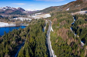 Aerial view of single carriageway section of the A9 highway at Pitlochry, Scotland, UK Iain Masterton /Scottish Viewpoint Scotland,Scottish,A9 road,highway,UK,United kingdom,Britain,british,construction industry,transport,transportation,infrastructure,aerial view,drone image,from above,winter,snow,rural highway,rural roa