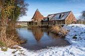 Historic Preston Mill seen in the snow in winter, East Linton, Scotland, UK, Iain Masterton /Scottish Viewpoint Scotland,Scottish,East Linton,East lothian,snow,winter,Preston Mill Scotland,wintry,cold weather,UK,united Kingdom,britain,british,historic,water mill,national trust for scotland,snow coverd,in the sn
