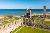 Aerial view from drone of St Andrews town and St Andrews Cathedral ruins, Fife, Scotland, UK and Iain Masterton /Scottish Viewpoint St Andrews,Scotland,scottish town,St Andrews Scotland,St Andrews Cathedral,ruins,ruined,St Andrews Fife,UK,united Kingdom,Britain,coastline,coastal,british,Fife Scotland,Europe,day,from above,aerial v