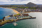 Aerial view of harbour and town of North Berwick in East Lothian, Scotland, UK Iain Masterton /Scottish Viewpoint North Berwick,Scotland,Scottish town,East lothian,UK,united Kingdom,Britain,harbour,aerial photography,from above,drone image,coast,coastal,harbours,British coast,North berwick scotland,daytime