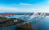 Aerial view of three major bridges crossing River Forth at North Queensferry, closest is Queensferry Crossing Bridge, Scotland UK Iain Masterton /Scottish Viewpoint Queensferry crossing bridge scotland,Scotland,aerial view,aerial photography,drone image,from above,Forth road bridge,forth bridge scotland,forth railway bridge scotland,three bridges crossing the riv
